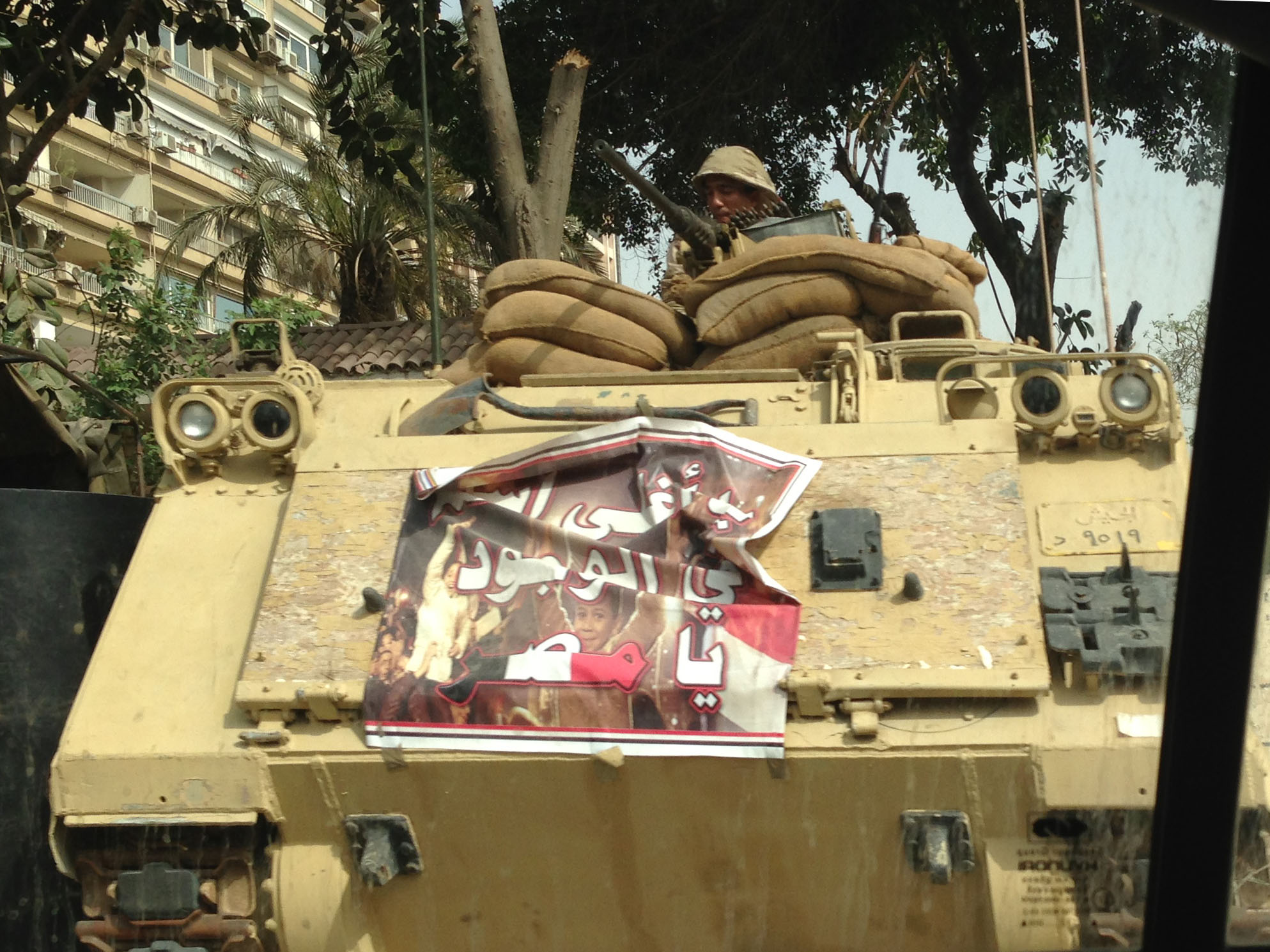 Propaganda poster on tank at military check point, El Maadi/Corniche, Cairo 2014
